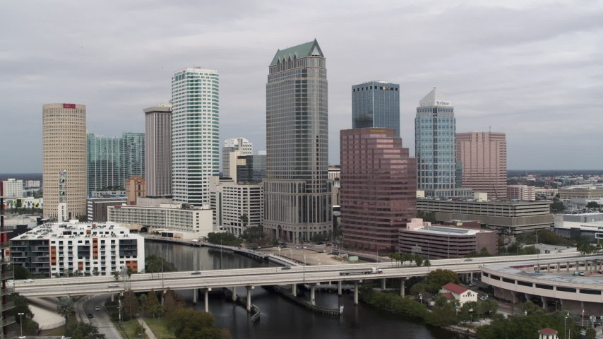 5.7K stock footage aerial video of flying away from tall skyscrapers in Downtown Tampa, Florida Aerial Stock Footage | DX0003_229_003