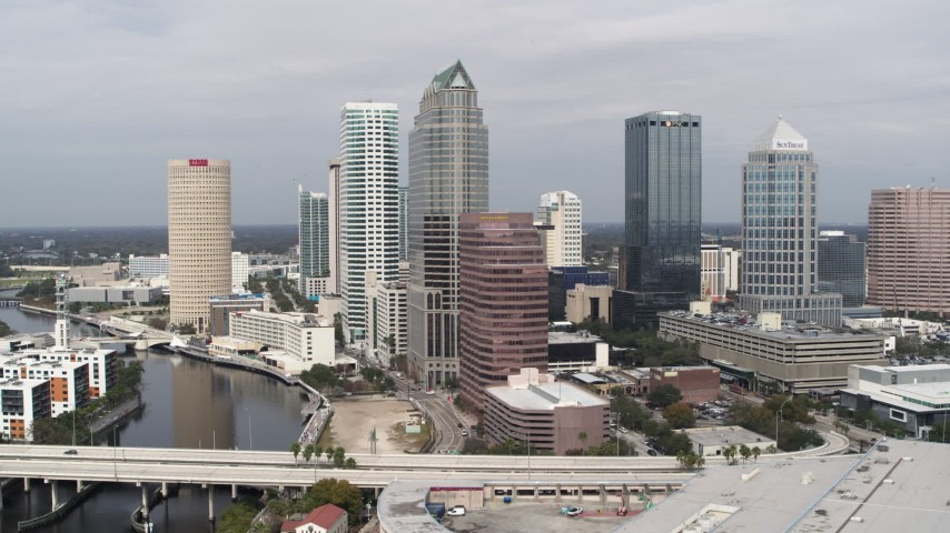 5.7K stock footage aerial video of flying away from skyscrapers, Downtown Tampa, Florida Aerial Stock Footage | DX0003_229_006
