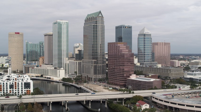 5.7K stock footage aerial video a view of skyscrapers while descending, Downtown Tampa, Florida Aerial Stock Footage | DX0003_229_008