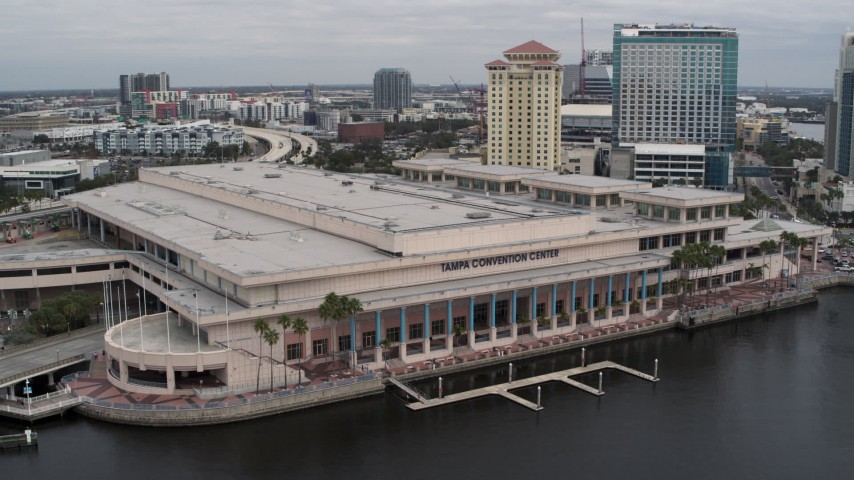 5.7K stock footage aerial video descend while focused on the convention center, Downtown Tampa, Florida Aerial Stock Footage | DX0003_229_014