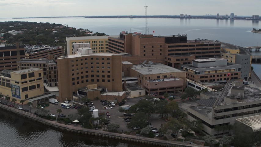 5.7K stock footage aerial video of orbiting a waterfront hospital in Tampa, Florida Aerial Stock Footage | DX0003_229_017