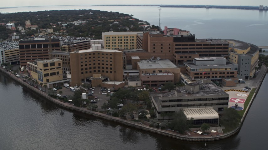 5.7K stock footage aerial video of circling a waterfront hospital in Tampa, Florida Aerial Stock Footage | DX0003_229_019