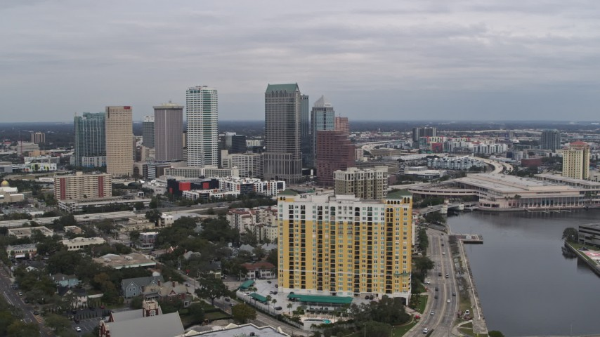 5.7K stock footage aerial video flying by condo complex with view of Downtown Tampa, Florida Aerial Stock Footage | DX0003_229_031