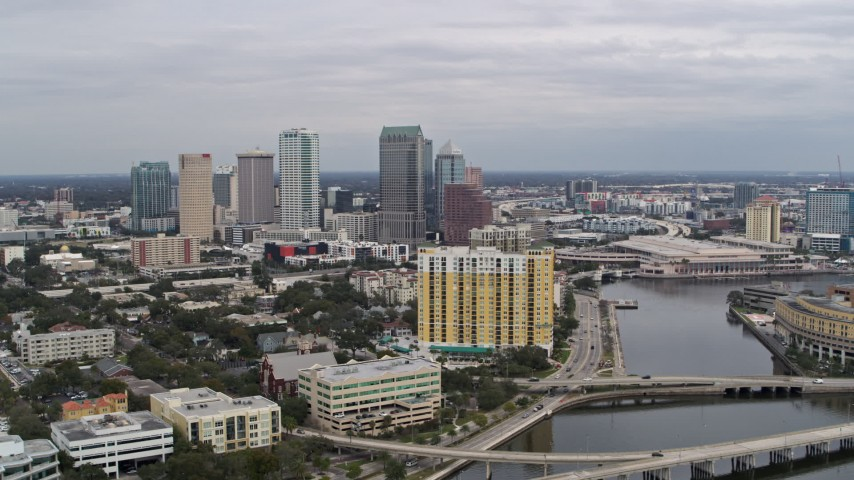 5.7K stock footage aerial video flying by bridges with view of Downtown Tampa, Florida Aerial Stock Footage | DX0003_229_032