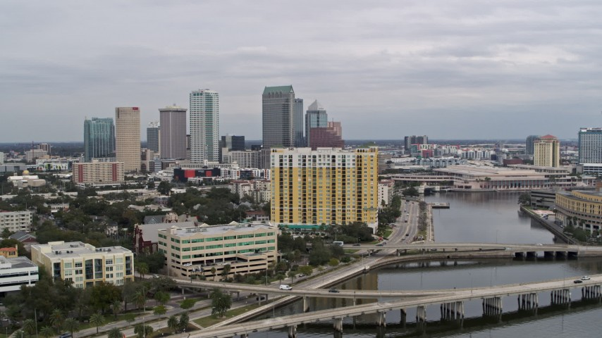 5.7K stock footage aerial video the city skyline seen while flying away from condo complex, Downtown Tampa, Florida Aerial Stock Footage | DX0003_229_036