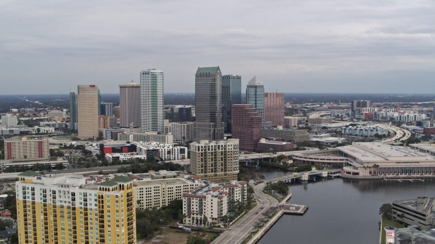5.7K stock footage aerial video fly away from the city skyline, Downtown Tampa, Florida Aerial Stock Footage | DX0003_229_039