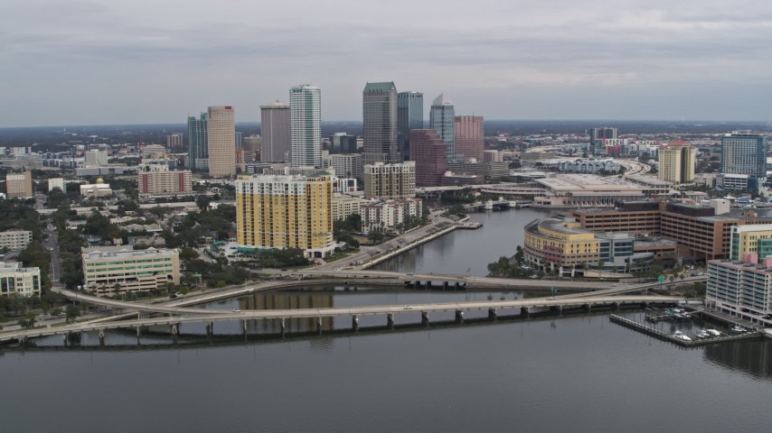 5.7K stock footage aerial video of flying by bridges and channel while focused on skyline, Downtown Tampa, Florida Aerial Stock Footage | DX0003_229_043