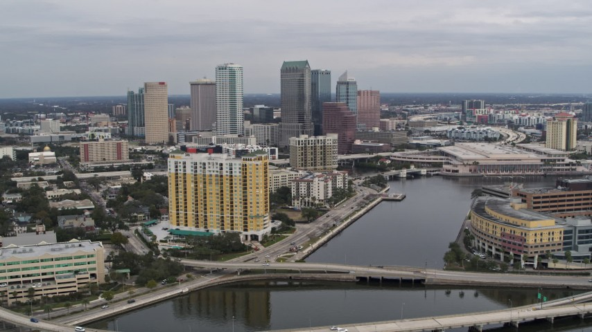 5.7K stock footage aerial video of flying over bridges and channel while focused on skyline, Downtown Tampa, Florida Aerial Stock Footage | DX0003_229_044