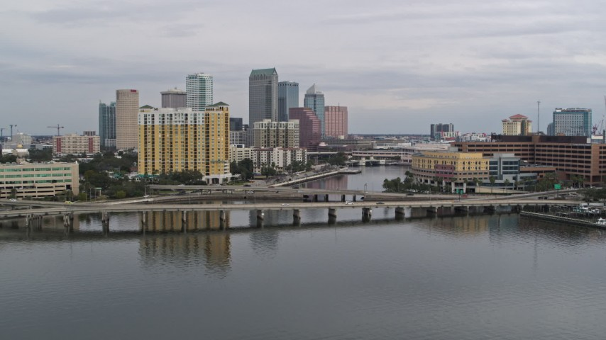 5.7K stock footage aerial video of the skyline seen while ascending over bridges, Downtown Tampa, Florida Aerial Stock Footage | DX0003_229_046
