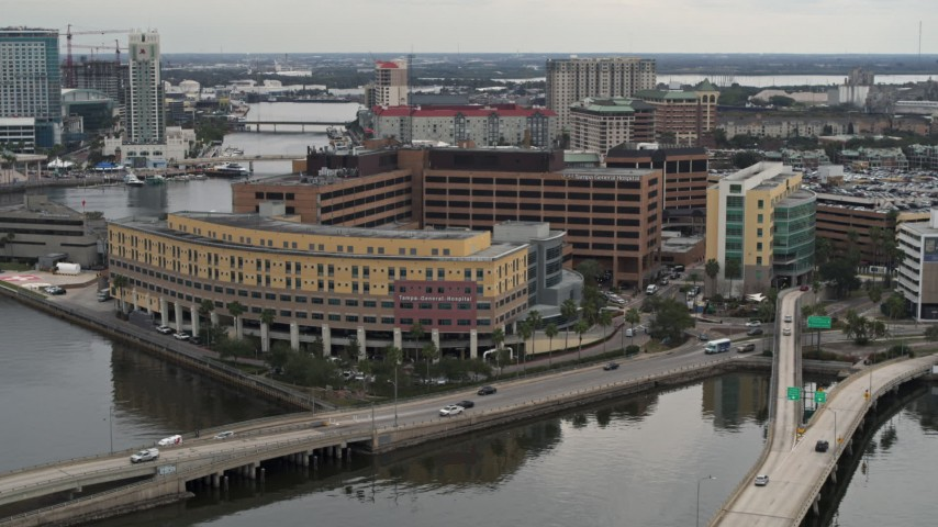 5.7K stock footage aerial video a reverse view of a waterfront hospital in Tampa, Florida Aerial Stock Footage | DX0003_230_003