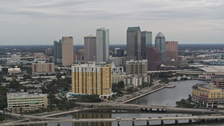 5.7K stock footage aerial video of the skyline from bridges and channel, Downtown Tampa, Florida Aerial Stock Footage | DX0003_230_006