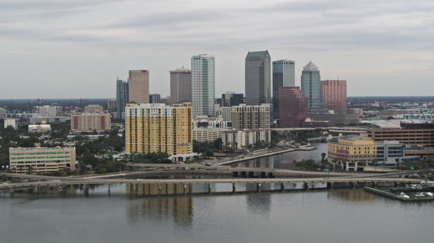 5.7K stock footage aerial video of the skyline, revealing bridges and channel, Downtown Tampa, Florida Aerial Stock Footage | DX0003_230_008
