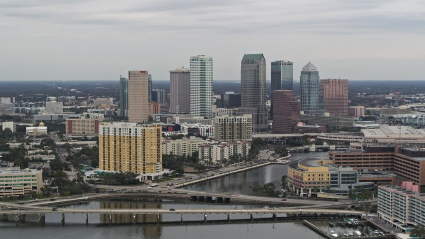 5.7K stock footage aerial video of the skyline, seen from bridges and channel near condos, Downtown Tampa, Florida Aerial Stock Footage | DX0003_230_009