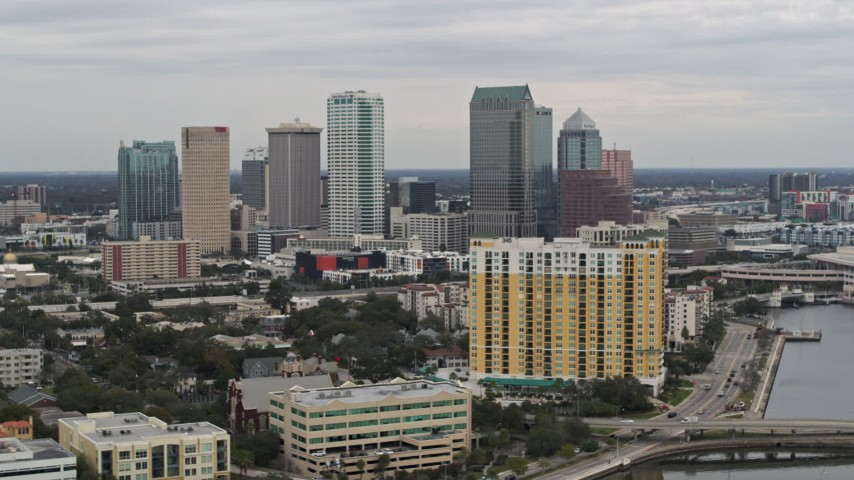 5.7K stock footage aerial video of the skyline, seen while passing condos, Downtown Tampa, Florida Aerial Stock Footage | DX0003_230_010