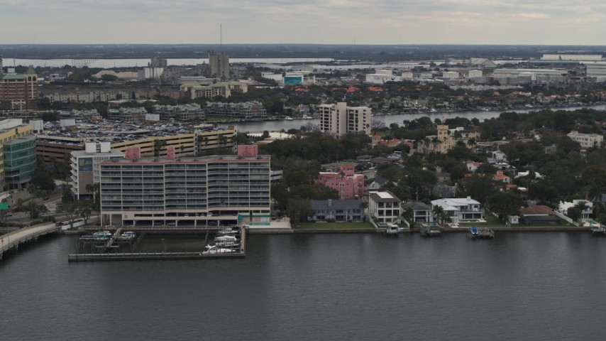 5.7K stock footage aerial video of passing by waterfront mansions and condo complex in Tampa, Florida Aerial Stock Footage | DX0003_230_021