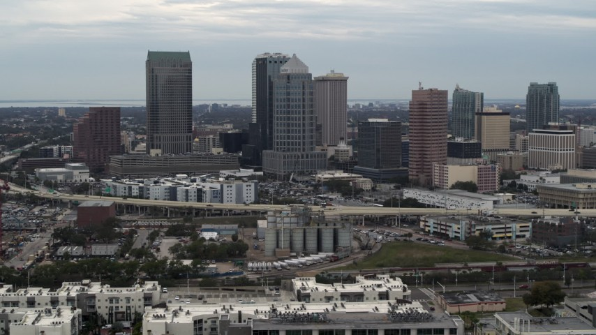 5.7K stock footage aerial video of flying by the downtown skyline, Downtown Tampa, Florida Aerial Stock Footage | DX0003_230_023