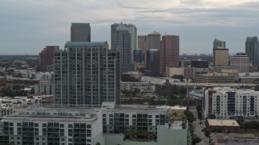 5.7K stock footage aerial video of flying by downtown skyline, reveal apartment complex, Downtown Tampa, Florida Aerial Stock Footage | DX0003_230_026