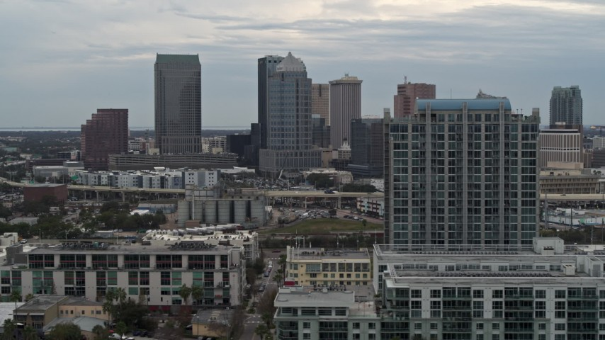 5.7K stock footage aerial video of flying by apartment complex, reveal skyline, Downtown Tampa, Florida Aerial Stock Footage | DX0003_230_027
