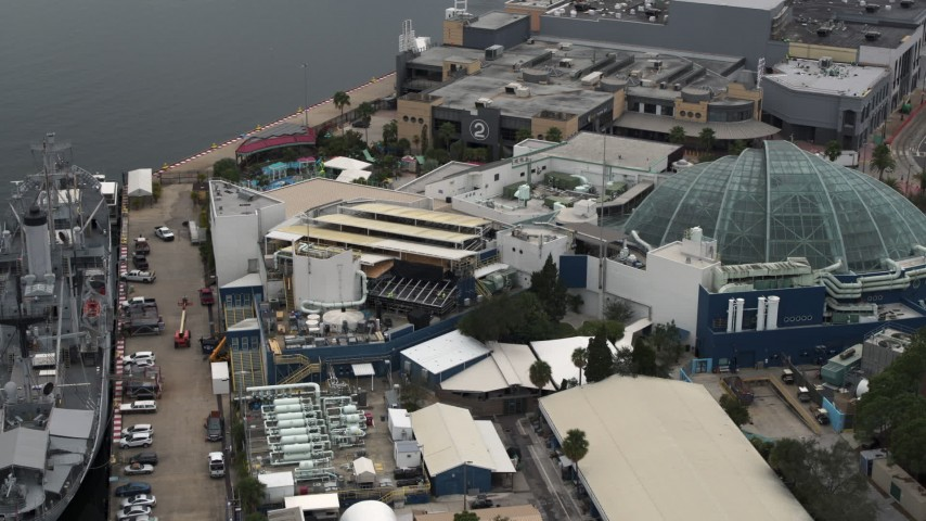 5.7K stock footage aerial video reverse view of a warship museum and aquarium in Tampa, Florida Aerial Stock Footage | DX0003_230_030