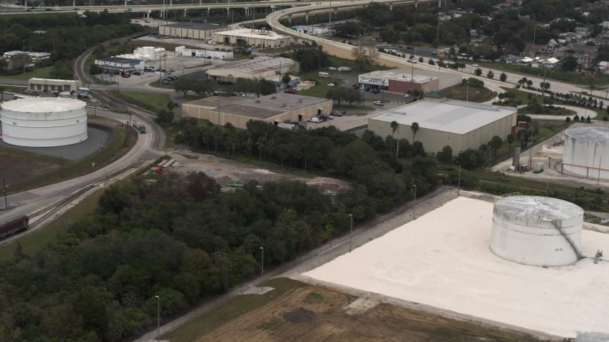 5.7K stock footage aerial video of warehouse buildings and storage tanks in Tampa, Florida Aerial Stock Footage | DX0003_230_034