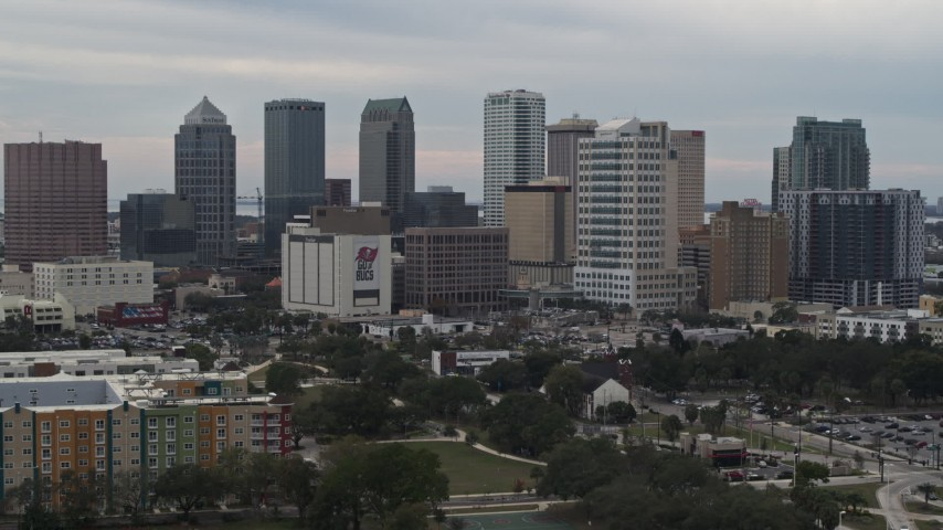 5.7K stock footage aerial video of tall skyscrapers in the city's skyline during descent, Downtown Tampa, Florida Aerial Stock Footage | DX0003_230_043