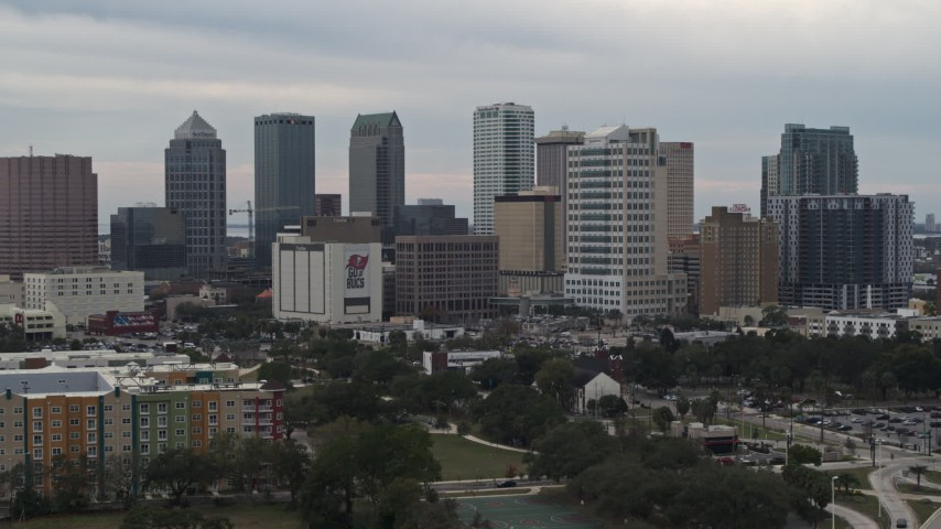 5.7K stock footage aerial video ascend for a view of tall skyscrapers in the city's skyline, Downtown Tampa, Florida Aerial Stock Footage | DX0003_230_044