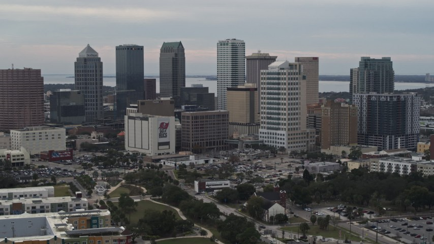 5.7K stock footage aerial video descend while focused on tall skyscrapers in the city's skyline, Downtown Tampa, Florida Aerial Stock Footage | DX0003_230_046