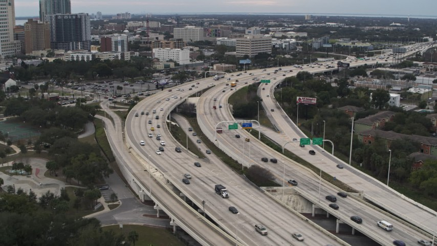 5.7K stock footage aerial video flyby and away from freeway traffic in Tampa, Florida Aerial Stock Footage | DX0003_231_003