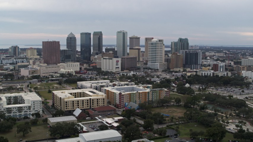 5.7K stock footage aerial video a wide view of passing by skyscrapers in the city's skyline, Downtown Tampa, Florida Aerial Stock Footage | DX0003_231_006