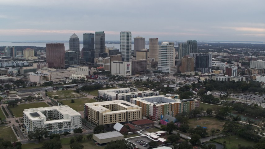 5.7K stock footage aerial video a wide view of passing by tall skyscrapers in the city's skyline, Downtown Tampa, Florida Aerial Stock Footage | DX0003_231_007