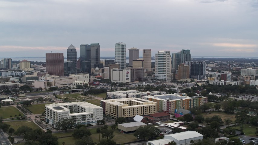 5.7K stock footage aerial video orbit apartment buildings with city's skyline in background, Downtown Tampa, Florida Aerial Stock Footage | DX0003_231_009