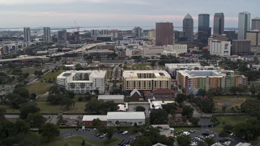 5.7K stock footage aerial video circling apartment buildings with city's skyline in background, Downtown Tampa, Florida Aerial Stock Footage | DX0003_231_010