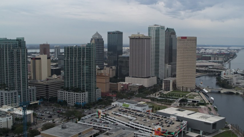 5.7K stock footage aerial video approach and orbit skyscrapers by the river, Downtown Tampa, Florida Aerial Stock Footage | DX0003_231_016
