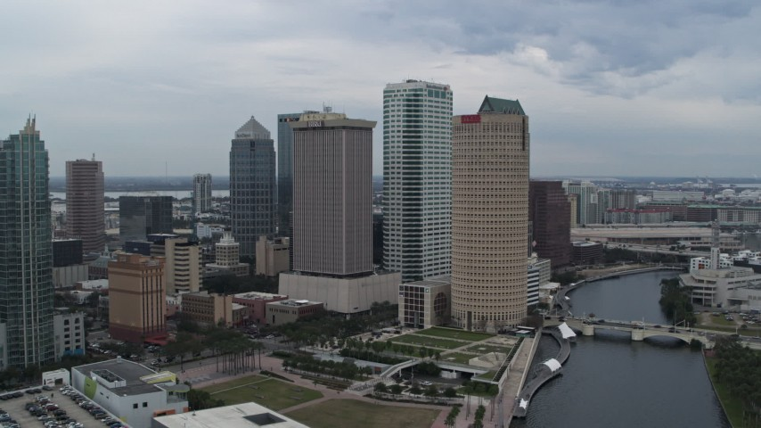 5.7K stock footage aerial video of orbiting skyscrapers by the river, Downtown Tampa, Florida Aerial Stock Footage | DX0003_231_019