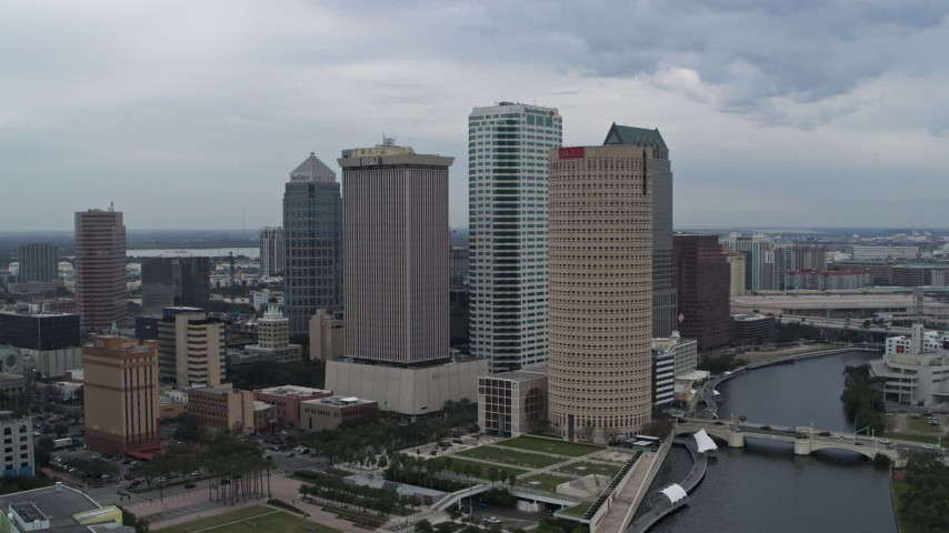 5.7K stock footage aerial video of a reverse view of skyscrapers by the river, Downtown Tampa, Florida Aerial Stock Footage | DX0003_231_020