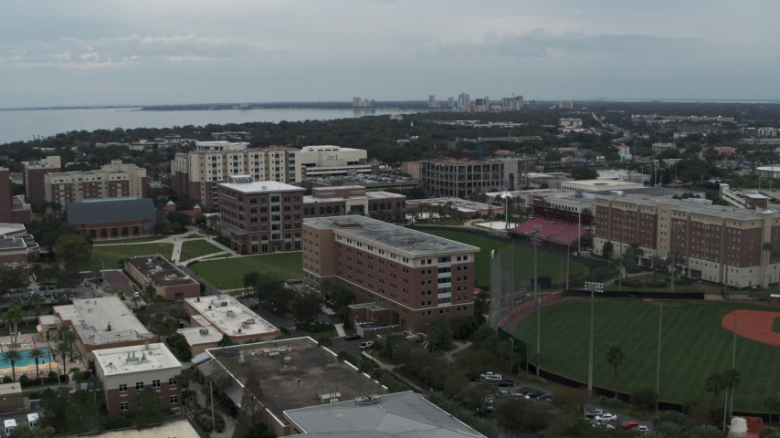 5.7K stock footage aerial video descend and fly away from the University of Tampa campus, Florida Aerial Stock Footage | DX0003_231_022