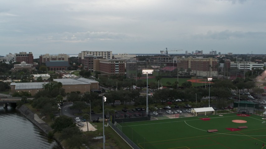 5.7K stock footage aerial video approach and ascend toward the University of Tampa campus, Florida Aerial Stock Footage | DX0003_231_023