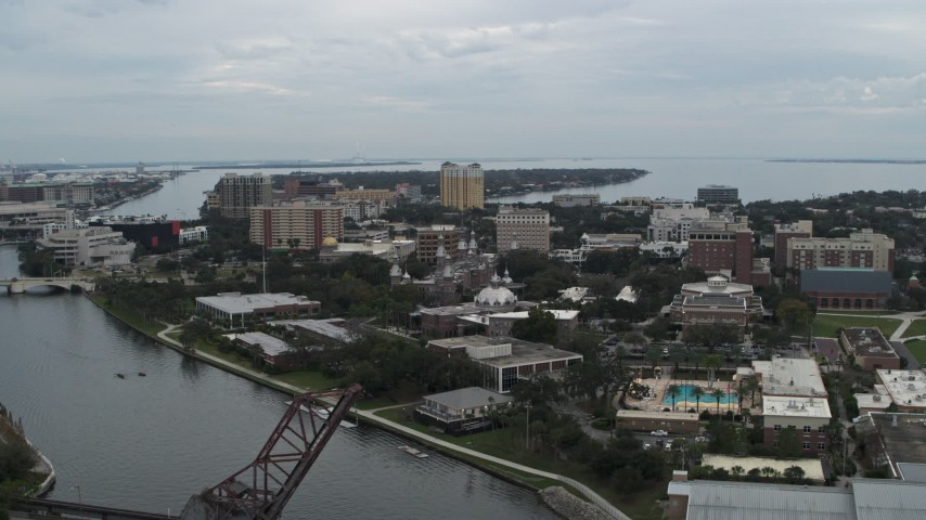 5.7K stock footage aerial video reverse view of the University of Tampa campus from the river, Florida Aerial Stock Footage | DX0003_231_024