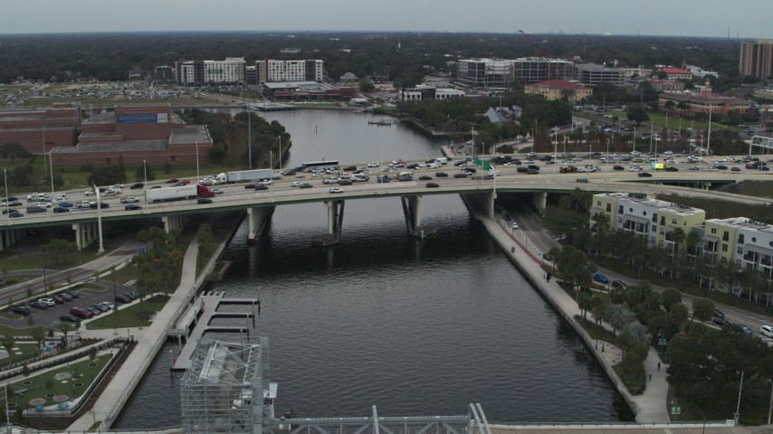 5.7K stock footage aerial video heavy traffic on a bridge spanning the river in Tampa, Florida Aerial Stock Footage | DX0003_231_027