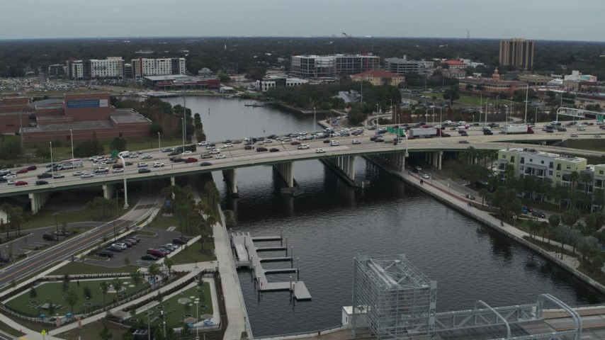 5.7K stock footage aerial video orbit and approach traffic on a bridge spanning the river in Tampa, Florida Aerial Stock Footage | DX0003_231_029