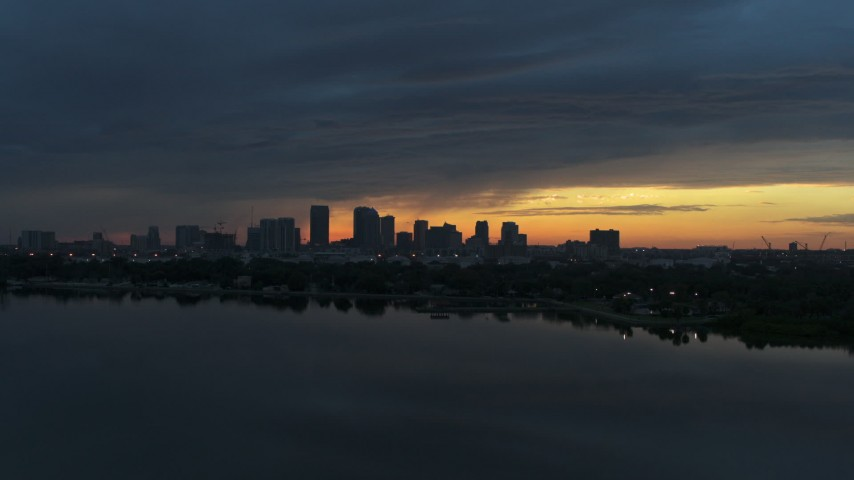 5.7K stock footage aerial video wide view of the distant city skyline of Downtown Tampa, Florida at sunset Aerial Stock Footage | DX0003_231_041