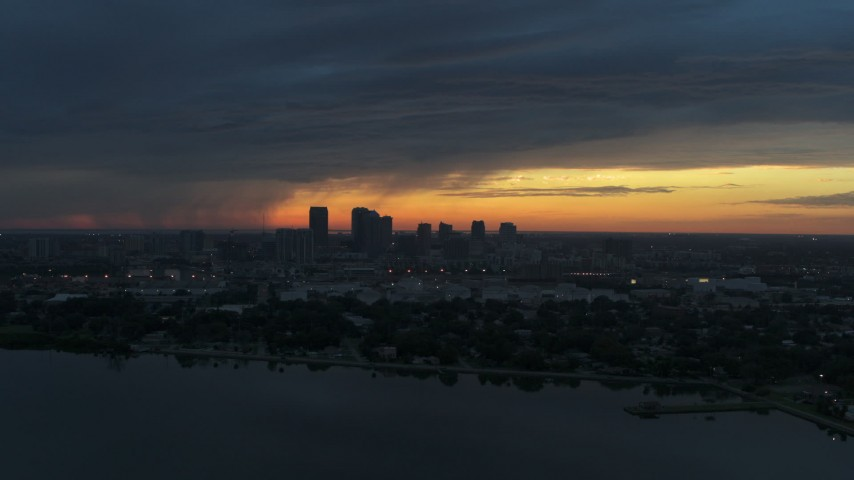 5.7K stock footage aerial video of the distant city skyline of Downtown Tampa, Florida at sunset Aerial Stock Footage | DX0003_231_042