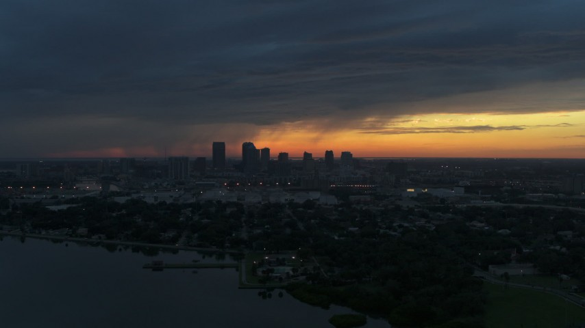 5.7K stock footage aerial video reverse view of the distant city skyline of Downtown Tampa, Florida at sunset Aerial Stock Footage | DX0003_231_043