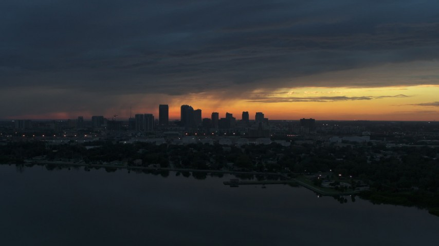 5.7K stock footage aerial video of the distant city skyline of Downtown Tampa, Florida at sunset Aerial Stock Footage | DX0003_231_044