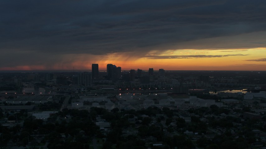 5.7K stock footage aerial video a reverse view of the Downtown Tampa skyline at sunset, Florida Aerial Stock Footage | DX0003_231_048