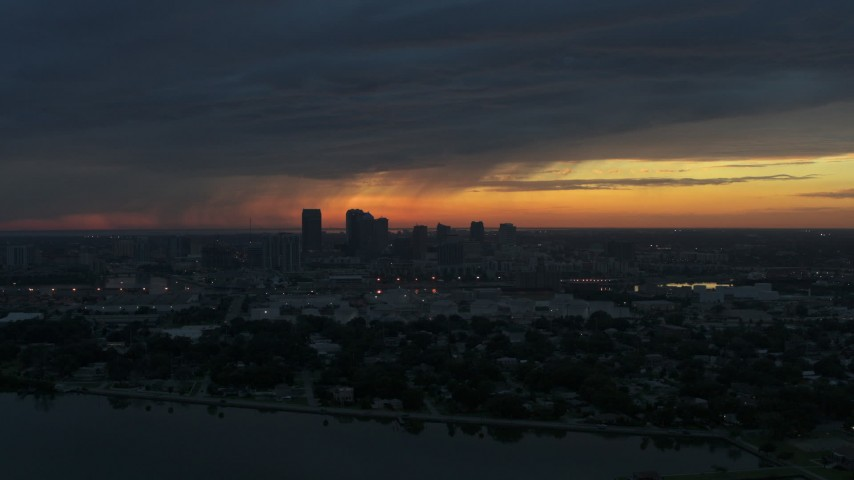 5.7K stock footage aerial video a reverse view of the Downtown Tampa skyline from the bay at sunset, Florida Aerial Stock Footage | DX0003_231_049