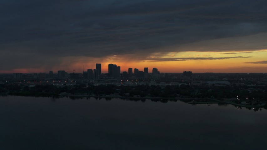 5.7K stock footage aerial video a view of the Downtown Tampa skyline from the bay at sunset, Florida Aerial Stock Footage | DX0003_231_050
