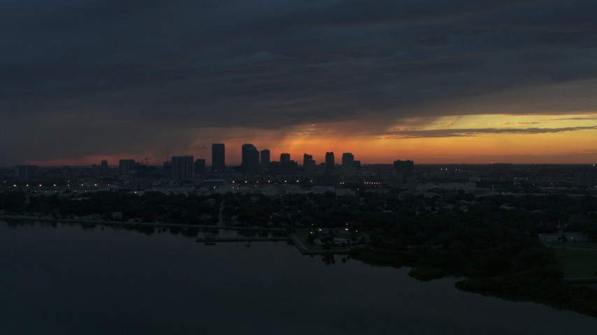 5.7K stock footage aerial video a view of the Downtown Tampa skyline while flying over the bay at sunset, Florida Aerial Stock Footage | DX0003_231_051