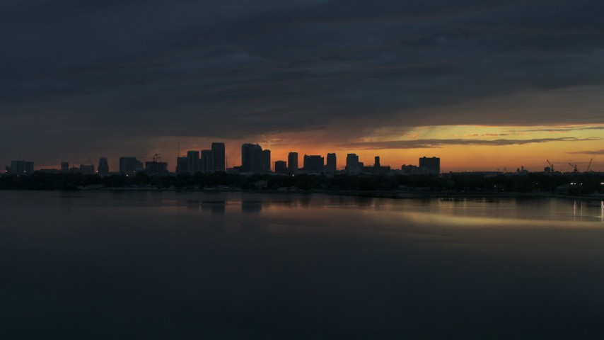 5.7K stock footage aerial video fly toward Downtown Tampa skyline from the bay at sunset, Florida Aerial Stock Footage | DX0003_231_053