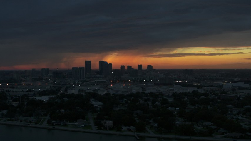 5.7K stock footage aerial video slowly fly away from Downtown Tampa skyline at sunset, Florida Aerial Stock Footage | DX0003_231_055